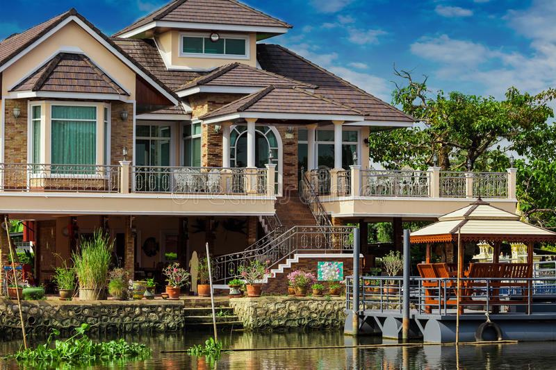 House on the river Nakhon Chai Si. In Thailand royalty free stock images