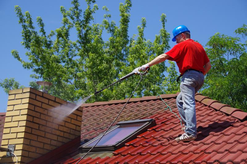 House roof cleaning with pressure tool stock image