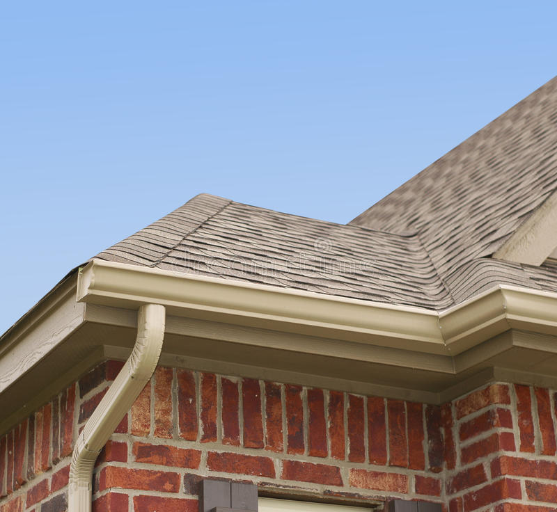 House Roof and Gutters. House roof, gutters and downspout on the corner of a house royalty free stock photos
