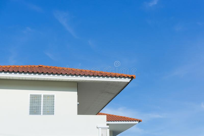House roof with large windows on blue sky background royalty free stock photo