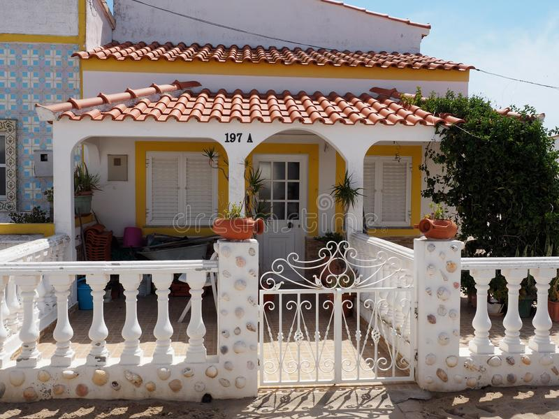 House With Roof Tiles and Patio On Ilha De Culatra Portugal. House With Decoative fence, roof tiles and patio in Culatra on the island of Culatra in the Algarve royalty free stock photo
