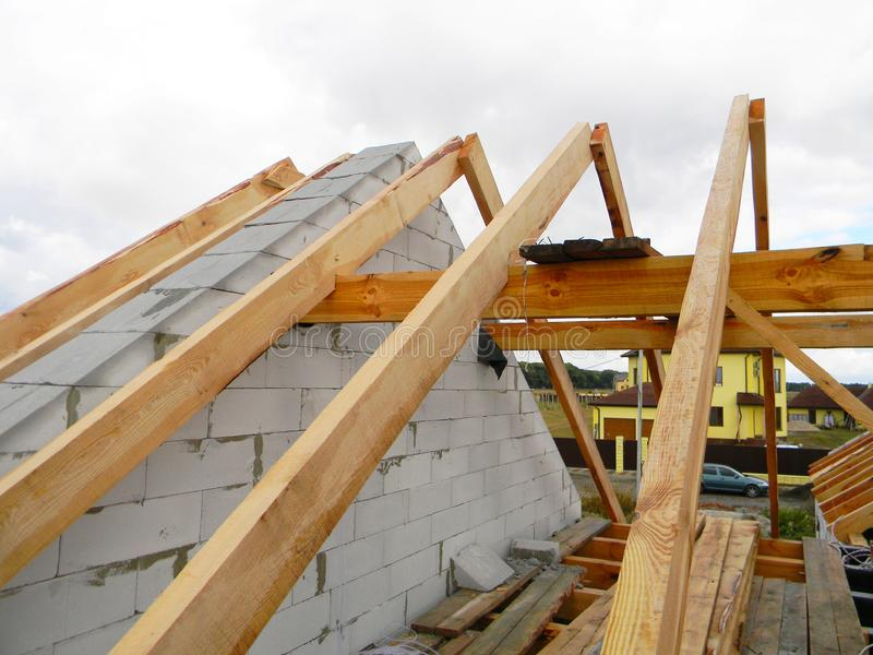 House roof top wooden frame construction. Unfinished house roofing construction wooden beams, trusses, timber. Photo stock photo
