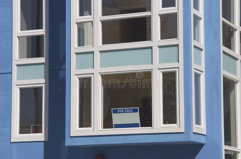 House For Sale. An empty house with a For Sale sign in the window stock images