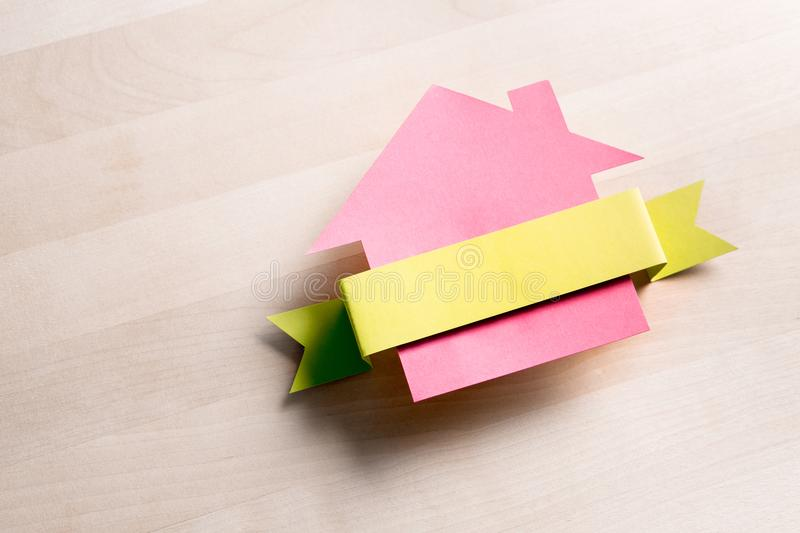 House for sale. Cottage made from cardboard paper. royalty free stock images