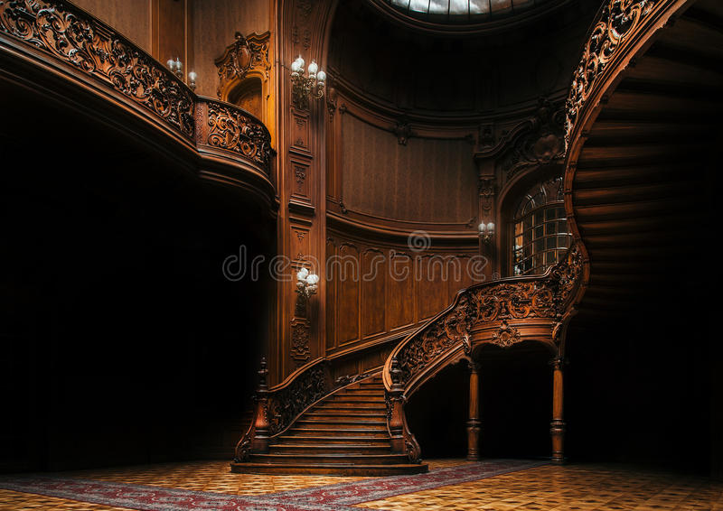 House of Scientists. Mansion with curved wooden staircase, Lviv, Ukraine. House of Scientists. Interior of the magnificent mansion with ornate grand wooden stock photography