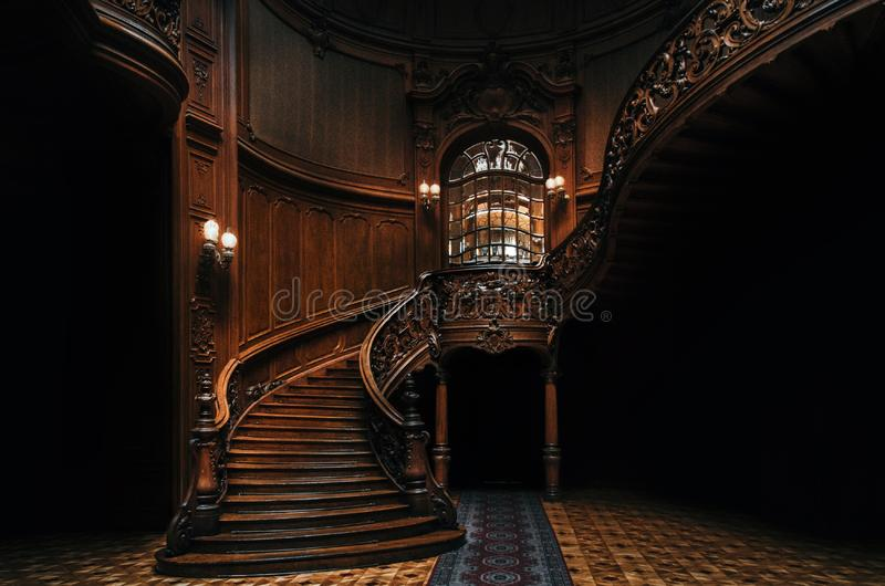 House of Scientists. Mansion with curved wooden staircase, Lviv, Ukraine. House of Scientists. Interior of the magnificent mansion with ornate grand wooden stock photo
