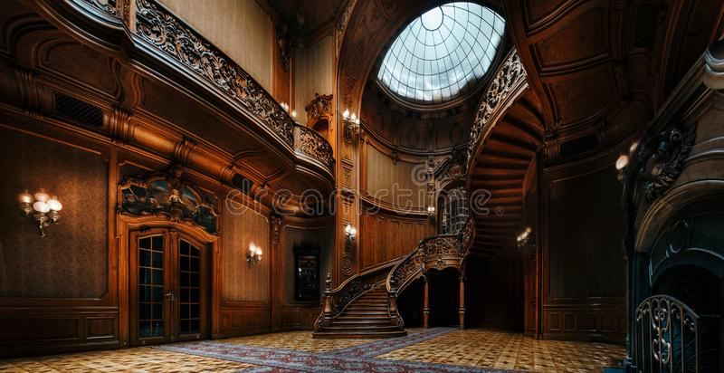 House of Scientists. Mansion with curved wooden staircase, Lviv, Ukraine. Lviv, Ukraine - 23 September, 2016: House of Scientists. Interior of the magnificent stock photo
