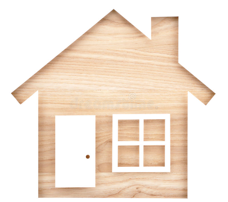 House shaped paper cutout on natural wood lumber. stock photos
