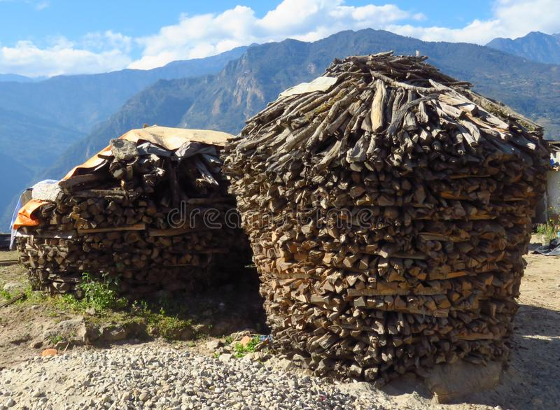 Pile of wood looking like a house drying in the sun, Num, Nepal. House shaped pile of wood drying in the sun, in the small village of Num, Nepal stock image