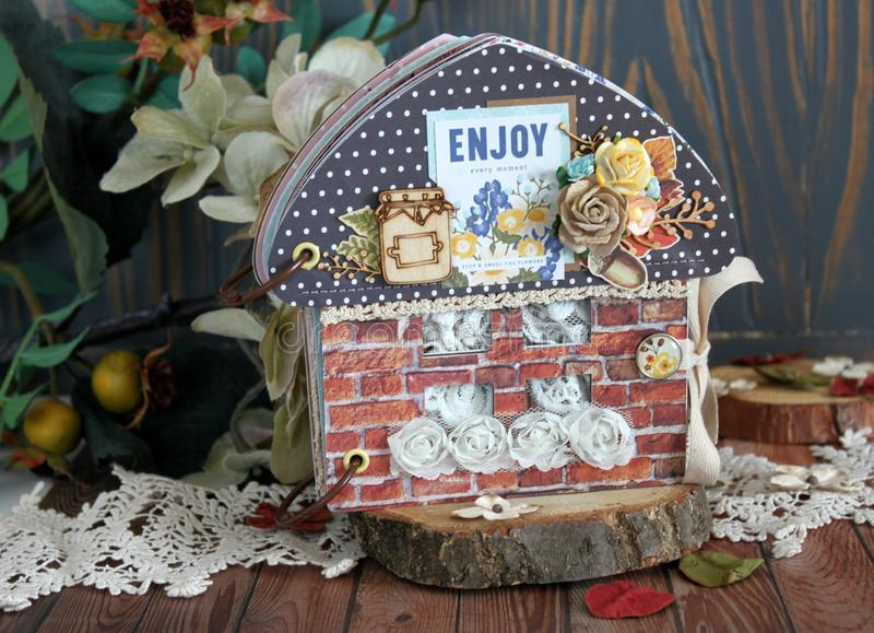 A house-shaped scrapbook with brick walls and black roof stock photos