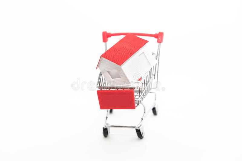 The house is in the shopping cart royalty free stock photos