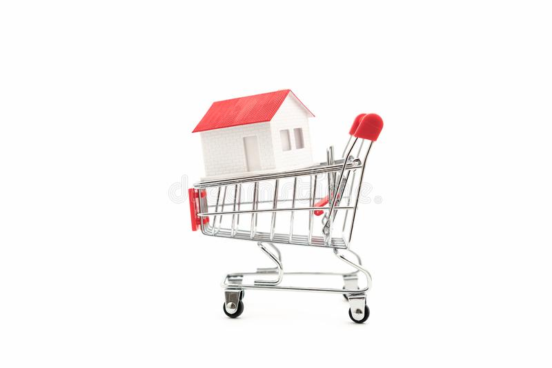 The house is in the shopping cart stock image