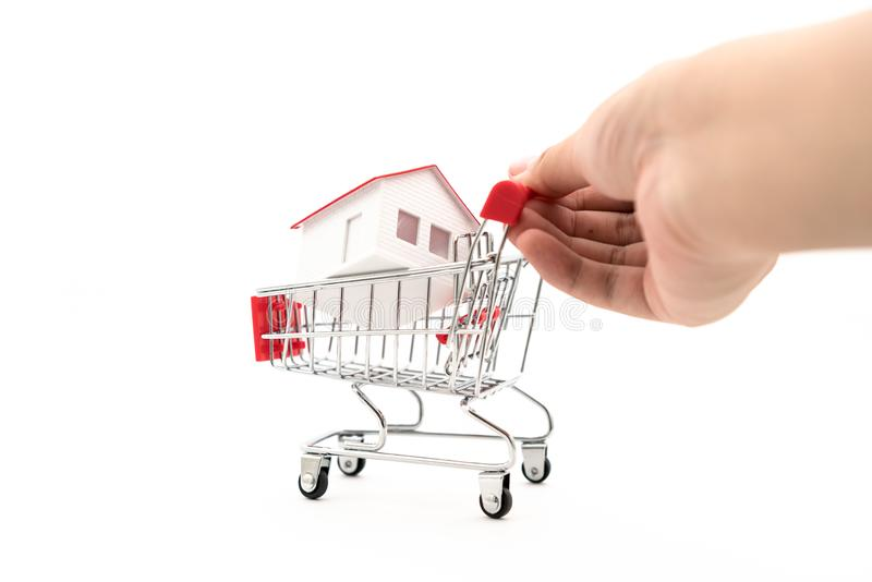 The house is in the shopping cart royalty free stock images