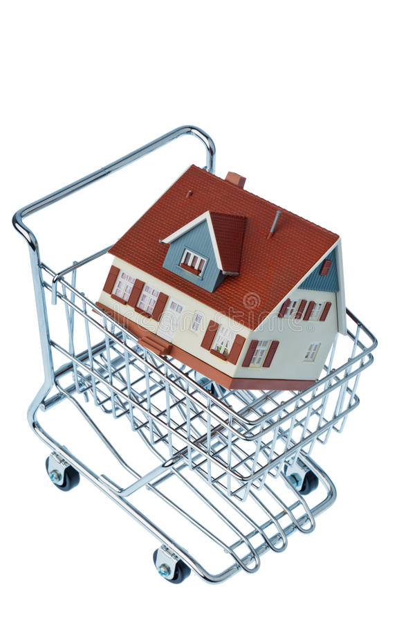 House in shopping cart royalty free stock images