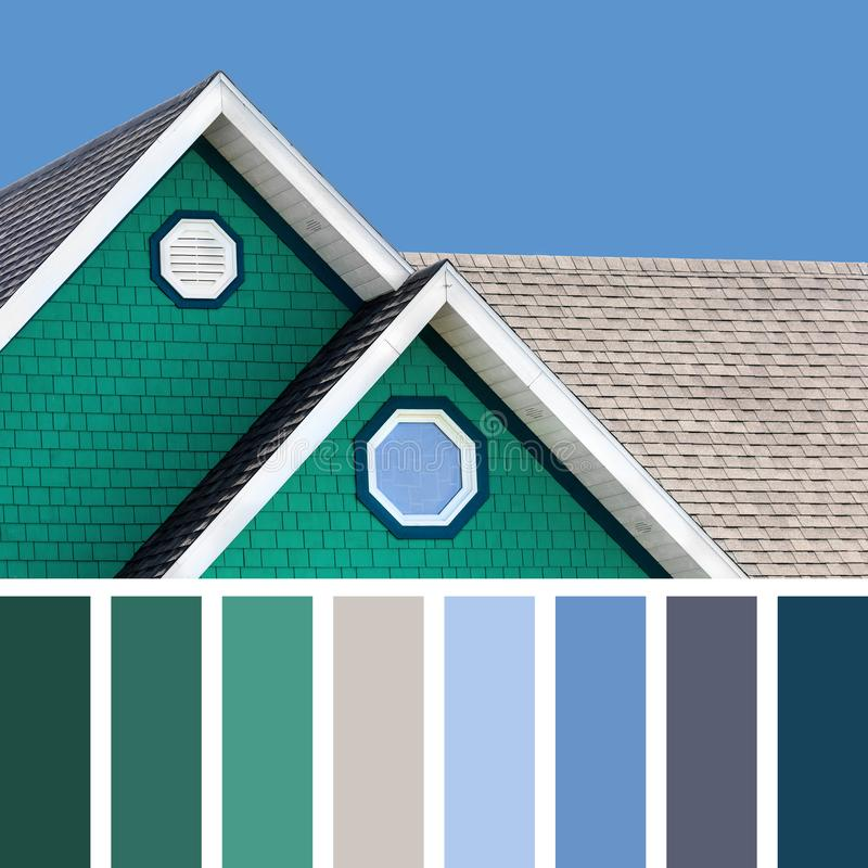 House and sky palette. The colour houses of the Magdalen Islands in Canada, with a blue sky background, In a colour palette with complimentary colour swatches stock photo