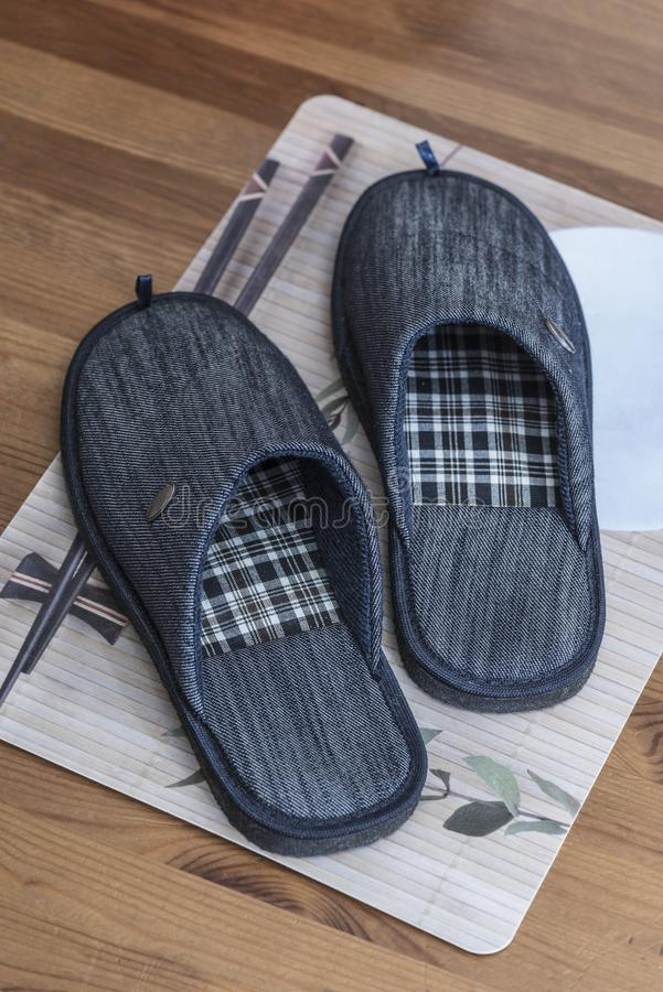 House slippers on the bedside mat on the floor. House slippers on a bedside mat on the wooden floor royalty free stock photography
