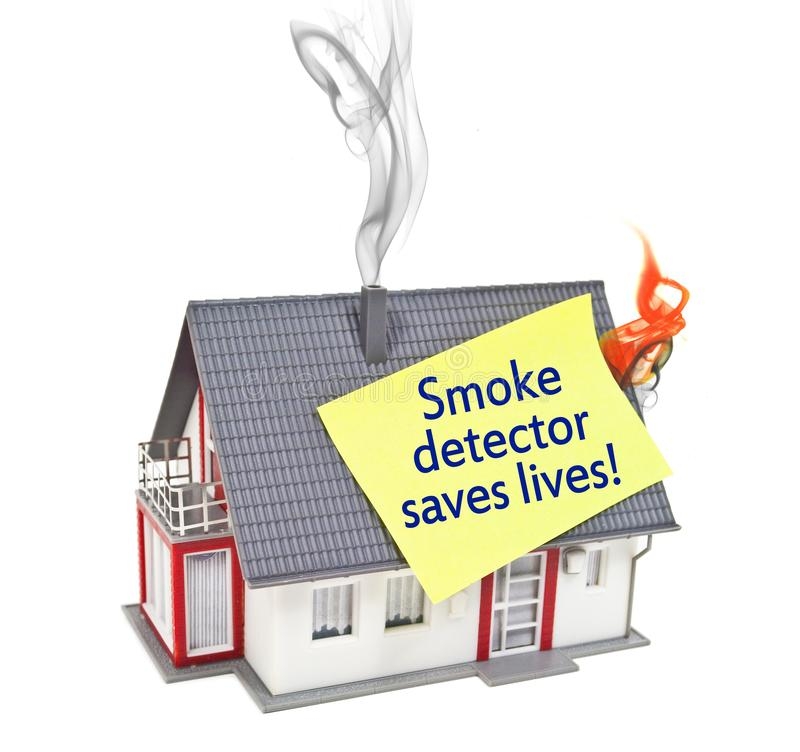 House with smoke and fire with smoke detector saves lives royalty free stock photos