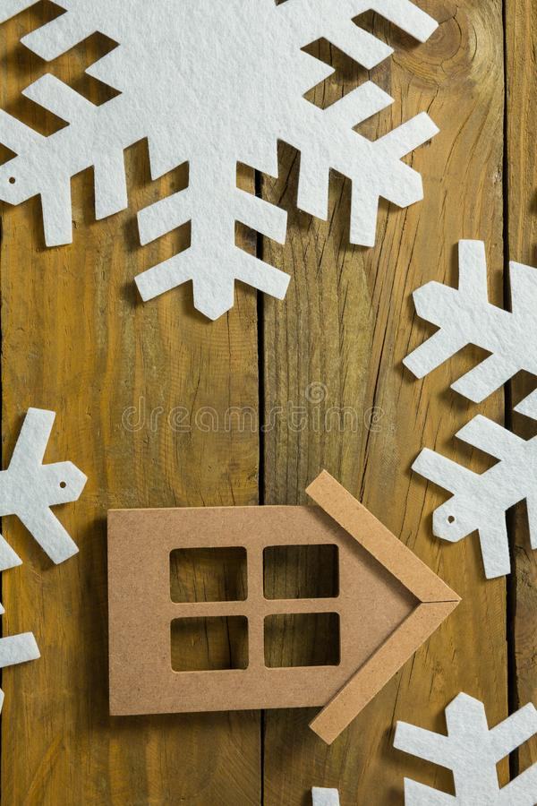 House with snow flake decoration. On wooden table royalty free stock photo