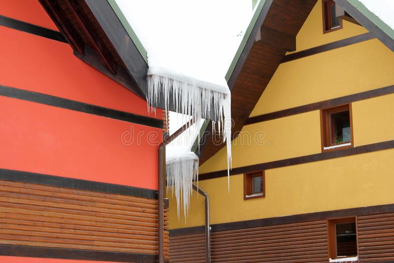 House snowy winter with icicles royalty free stock image