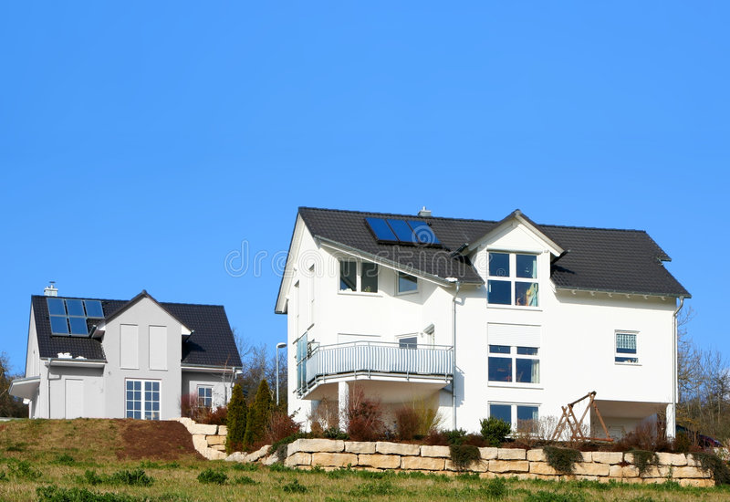 House with solar cell. 2 houses with solar cells on the roof royalty free stock images