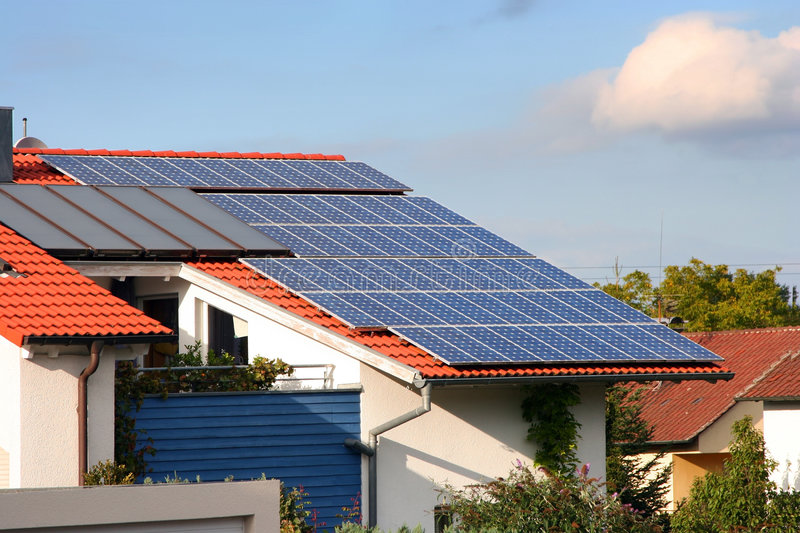 House with solar panels on the stock images