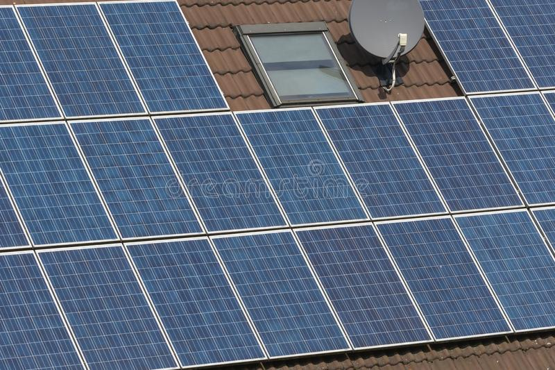 A house with solar panels on roof stock images