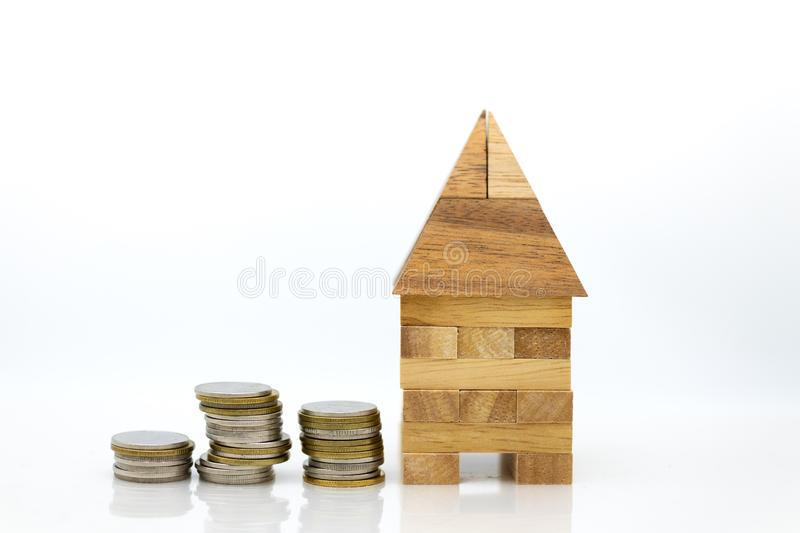 House with stack of coins. Image use for financial, loan money, business concept.  royalty free stock photography