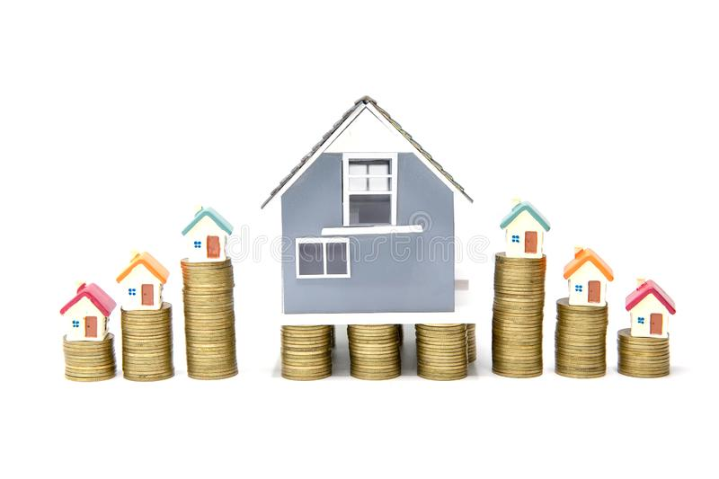 House on stack of coins isolated on white background,  Real estate investment, Save money with stack coin, Business growth. Investment and financial, Mortgage stock image