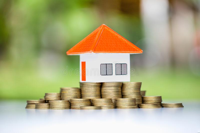 House on stack of coins,Money and house, Mortgage concept, Real estate investment, Real estate business success, Save money with stock image