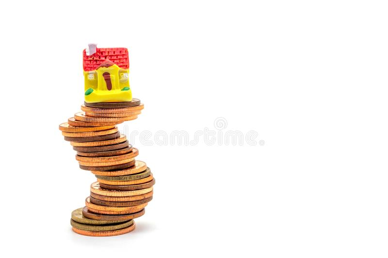House on stack on white background. Concept uncertainty in the real estate housing market stock photo