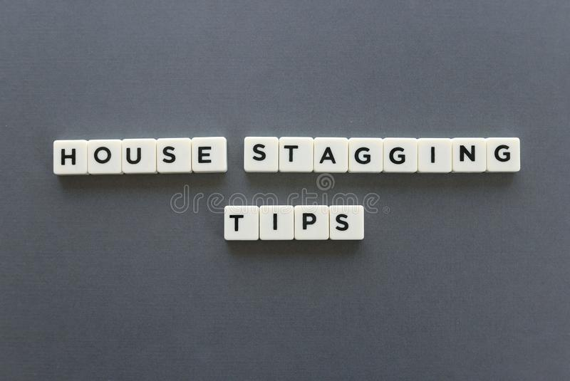 House staging tips word made of square letter word on grey background. House staging tips word made of square letter word on grey background stock photo