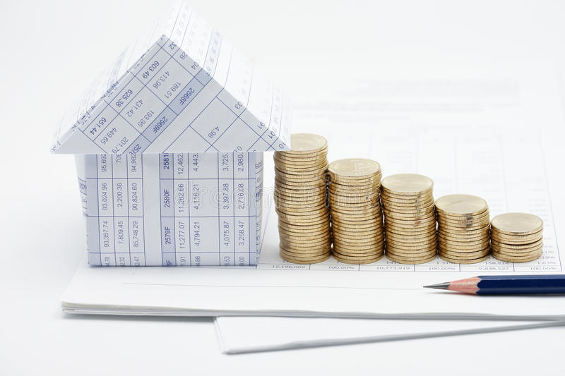 House and step pile of gold coins stock image