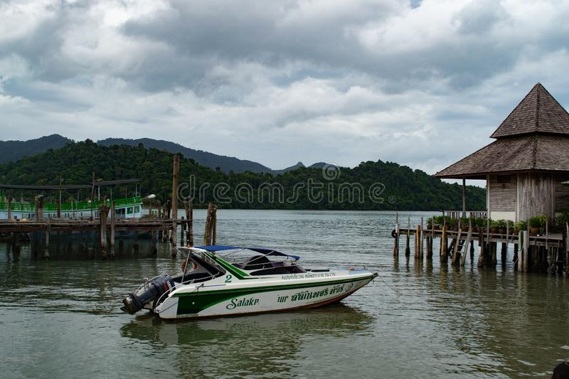 House on stilts and powerboat in fishing village. Koh Chang, Thailand stock images