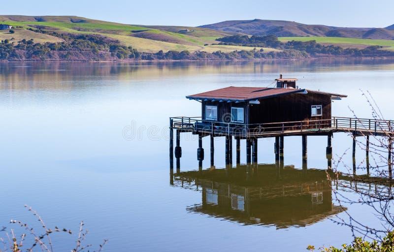 House on stilts on the shoreline of Tomales Bay, North San Francisco Bay Area, California stock photos