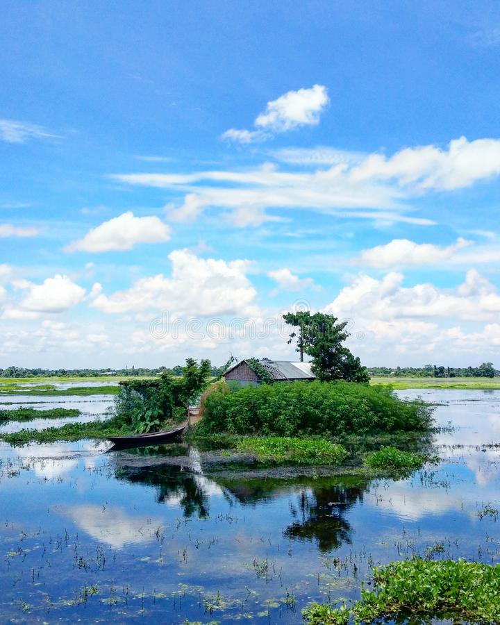 House Submerged by flood. 11th July 2018, Barpeta, Assam, India. A house Submerged by flood in a village of district of Barpeta, Assam royalty free stock image
