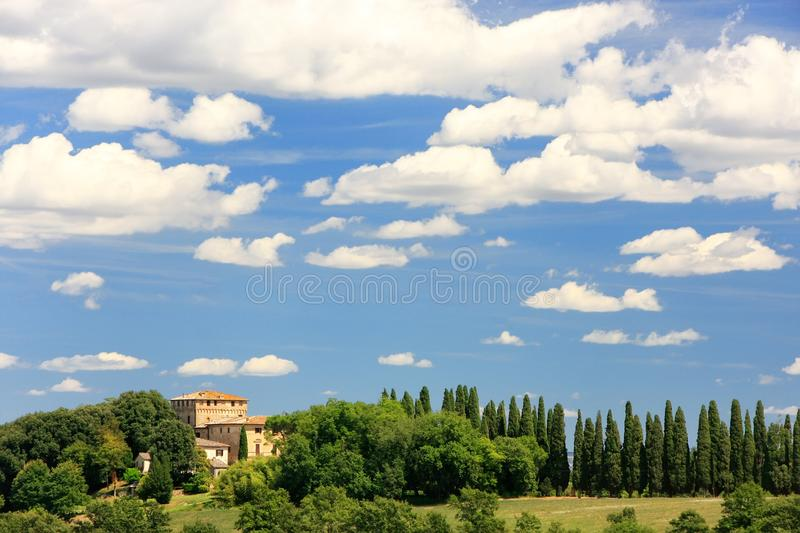 House surrounded by trees in Val d`Orcia, Tuscany, Italy. In 2004 the Val d'Orcia was added to the UNESCO list of World Heritage Sites royalty free stock images