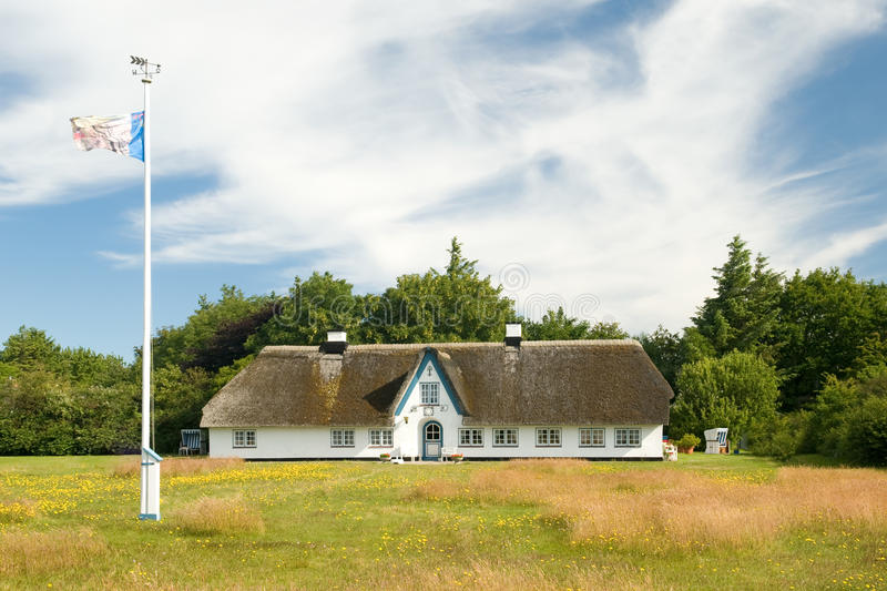 House with thatched roof stock images