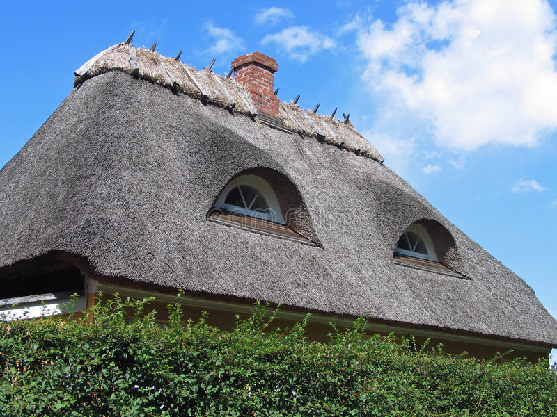House with thatched roof. Country house with old style thatched straw roof in Denmark royalty free stock photo