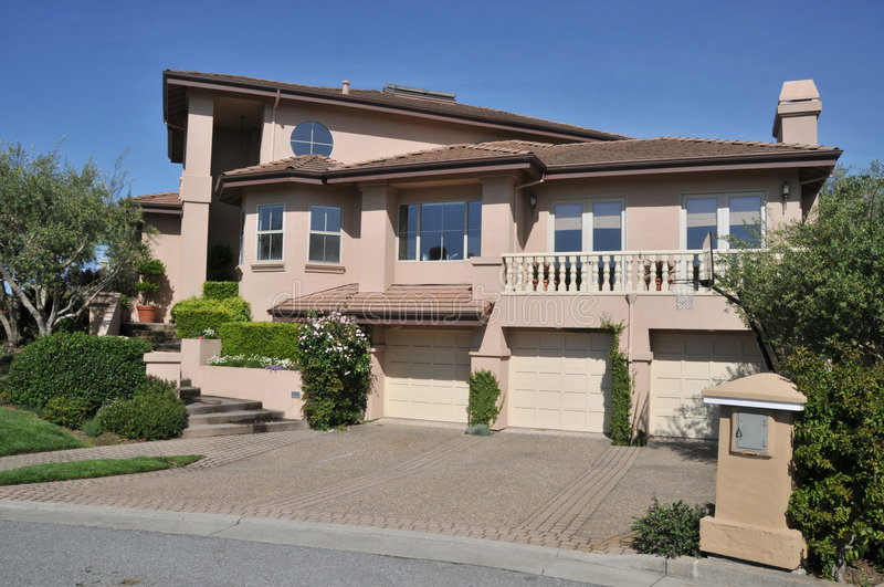 House with three car garage two stories stock image for How big is a one car garage