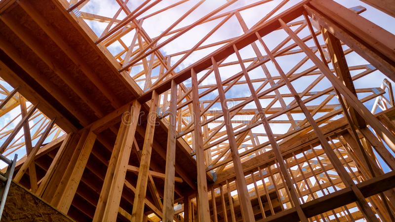 House timber frame for a progressing house a new development timber. Building frame structure on a new development timber frame for a progressing house stock photos