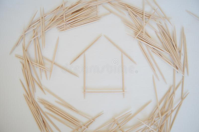 House of toothpicks. Simple and clear at the same time all the abstraction on the subject of basic human needs - food and shelter stock photo