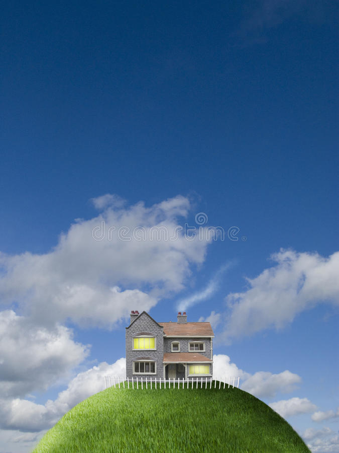 House on top of grassy globe stock photo