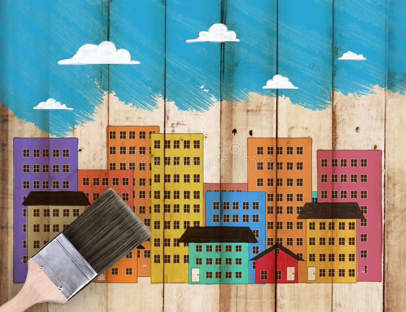 House on top of paintbrush with paint. Dripping down royalty free stock image