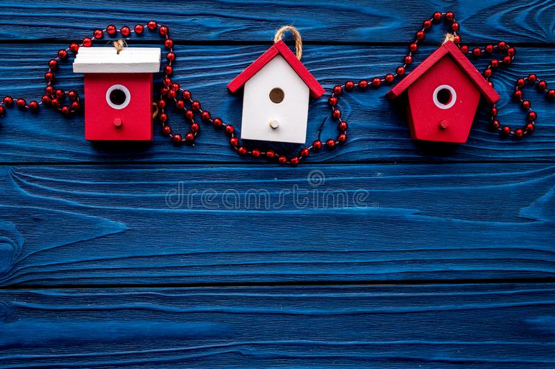 House toys to decorate christmas tree for new year celebration on blue wooden background top veiw mockup. House toys to decorate christmas tree for new year royalty free stock photography