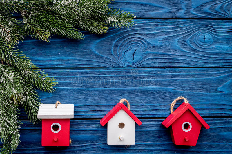 House toys to decorate christmas tree for new year celebration with fur tree branches on blue wooden background top veiw royalty free stock images