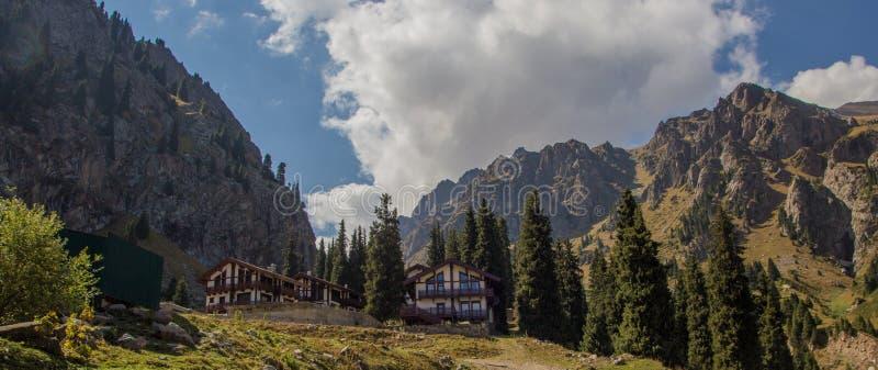 House at Tuyk su gorge near Shymbulak ski resort. Tien Shan mountains at summer time, Almaty, Kazakhstan royalty free stock photos
