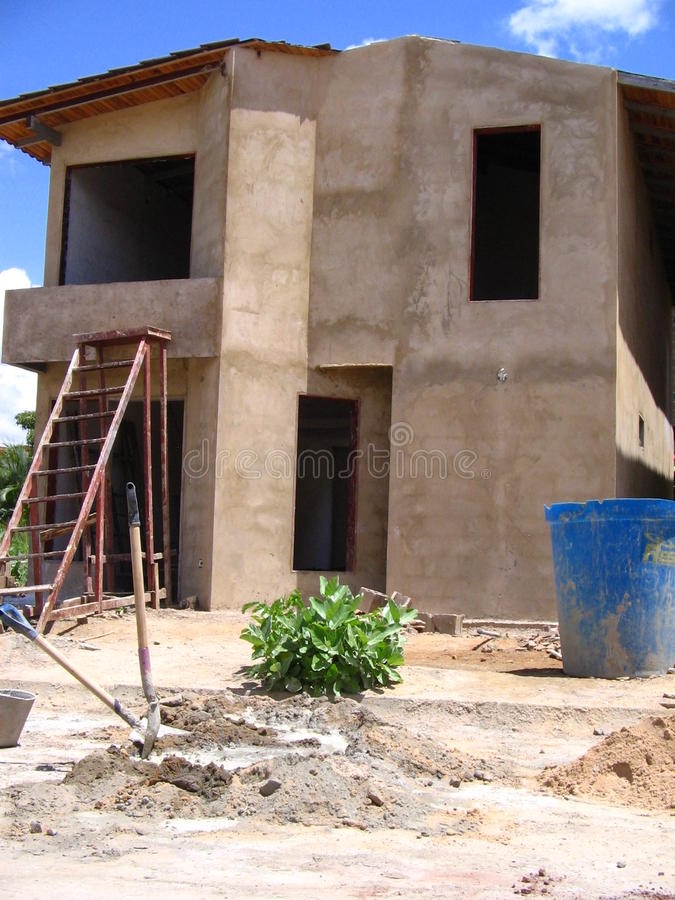 House of two levels in process of construction. Typical Venezuelan architecture. Dwellings of two levels in stage of construction, its structure columns, bases stock image