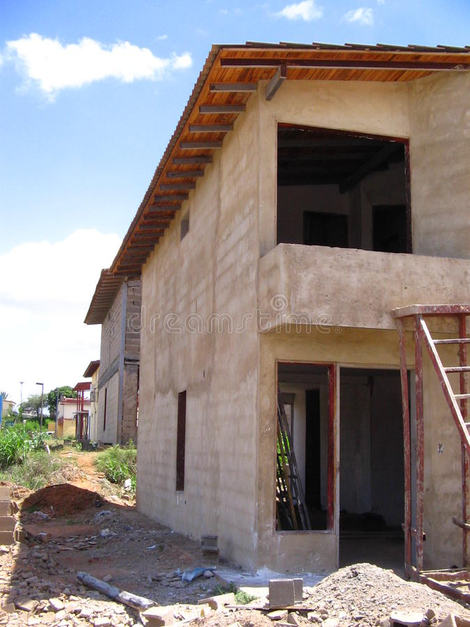 House of two levels in process of construction. Typical Venezuelan architecture. Dwellings of two levels in stage of construction, its structure columns, bases royalty free stock photo
