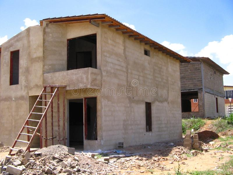 House of two levels in process of construction. Typical Venezuelan architecture. Dwellings of two levels in stage of construction, its structure columns, bases royalty free stock image