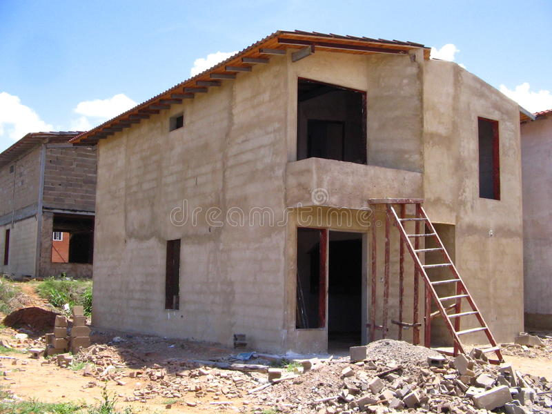 House of two levels in process of construction. Typical Venezuelan architecture. Dwellings of two levels in stage of construction, its structure columns, bases stock photo